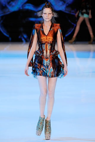 Model wearing an outfit from Alexander McQueen's Darwin inspired Spring 2010 collection