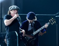 Singer Brian Johnson (L) and guitarist Angus Young of AC/DC perform onstage during The 57th Annual GRAMMY Awards