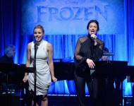 Kristen Bell and Idina Menzel perform during a live version of the 'Frozen' soundtrack.