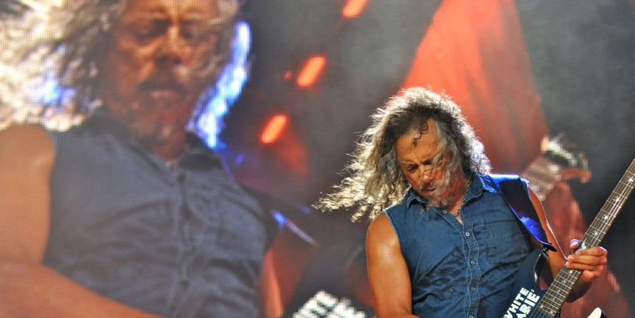 Giant Kirk Hammett plays a harmonic for little Kirk Hammett.