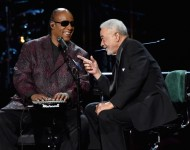 Stevie Wonder and Bill Withers share an inside joke.