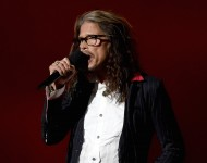 Singer Steven Tyler of Aerosmith speaks onstage during the 50th Academy of Country Music Awards at AT&T Stadium