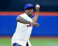 Rap artist 50 Cent throws the ceremonial first pitch of a game between the New York Mets and the Pittsburgh Pirates at Citi Field on May 27, 2014 in the Flushing neighborhood of the Queens borough of New York City.