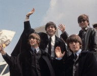 The Beatles (from left to right, John Lennon (1940 - 1980), George Harrison (1943 - 2001), Paul McCartney and Ringo Starr) arrive back at London Airport after their Australian tour.