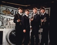 Liverpudlian beat combo The Beatles, from left to right Paul McCartney, Ringo Starr, John Lennon (1940 - 1980), and George Harrison (1943 - 2001), performing in front of a camera-shaped drum kit on Granada TV's Late Scene Extra television show filmed in