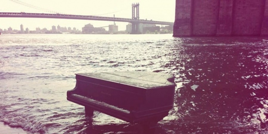 VIDEO: Piano Lady Sits in East River with a Washed Up Grand Piano, No One Lays Claim to Mysterious Instrument Washed Ashore
