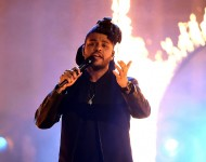 The Weeknd performs onstage during the 2015 American Music Awards