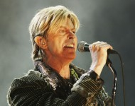 David Bowie performs on stage on the third and final day of The Nokia Isle of Wight Festival 2004