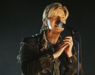 David Bowie performs on stage on the third and final day of 'The Nokia Isle of Wight Festival 2004' at Seaclose Park