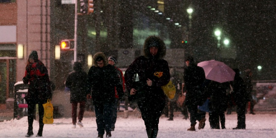 Pedestrians walk through Times Square on January 26, 2015 in New York City. New York, and much of the Northeast, is bracing for a major winter storm which is expected to bring blizzard conditions and 10 to 30 inches of snow to the area.