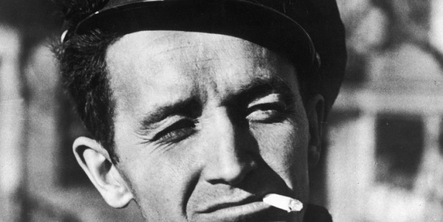 Woody Guthrie smoking & squinting
