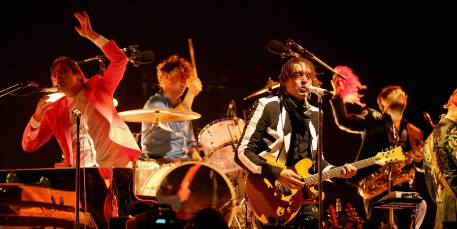 Arcade Fire performs onstage during day 3 of 2014 Coachella