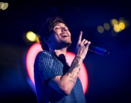 Louis Tomlinson of One Direction performs onstage during 102.7 KIIS FM's Jingle Ball 2015