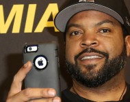 Ice Cube takes a picture with his mobile phone during a photo call for the film 'Ride Along: Next Level Miami' at Kino in der Kulturbrauerei