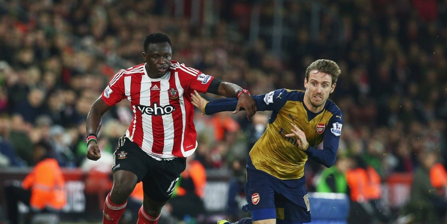 Victor Wanyama of Southampton battles with Nacho Monreal of Arsenal during the Barclays Premier League match between Southampton and Arsenal at St Mary's Stadium on December 26, 2015 in Southampton, England.