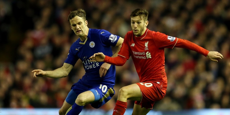 Adam Lallana of Liverpool (r) holds off Andy King of Leicester City during the Barclays Premier League match between Liverpool and Leicester City at Anfield on December 26, 2015 in Liverpool, England.