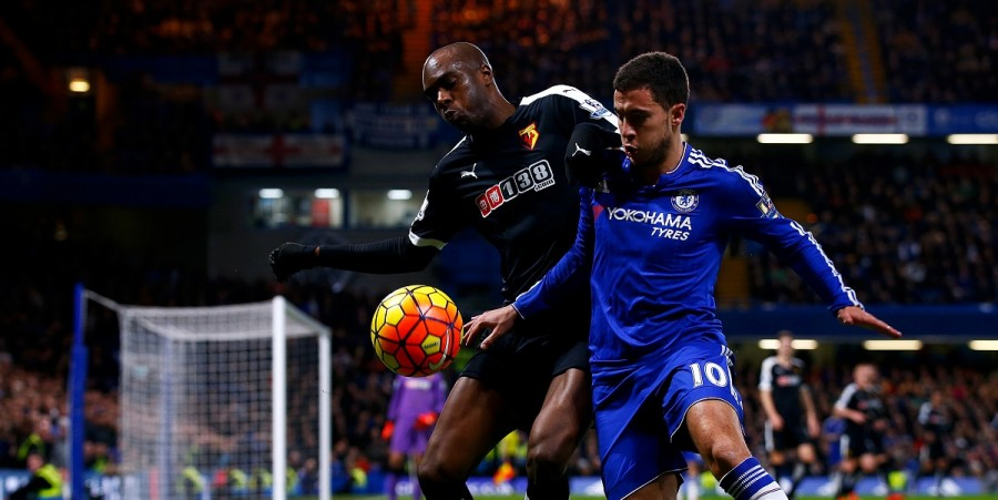 Allan-Romeo Nyom of Watford battles for the ball with Eden Hazard of Chelsea during the Barclays Premier League match between Chelsea and Watford at Stamford Bridge on December 26, 2015 in London, England.