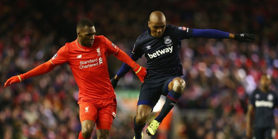 Angelo Ogbonna Obinza of West Ham United battles with Christian Benteke (L) and Joao Carlos Teixeira of Liverpool (R) during the Emirates FA Cup Fourth Round match between Liverpool and West Ham United at Anfield on January 30, 2016 in Liverpool, England