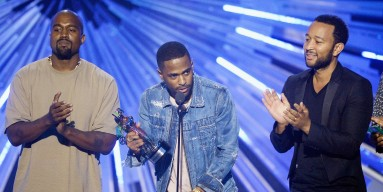 Kanye West, Big Sean and John Legend onstage during the 2015 MTV Video Music Awards