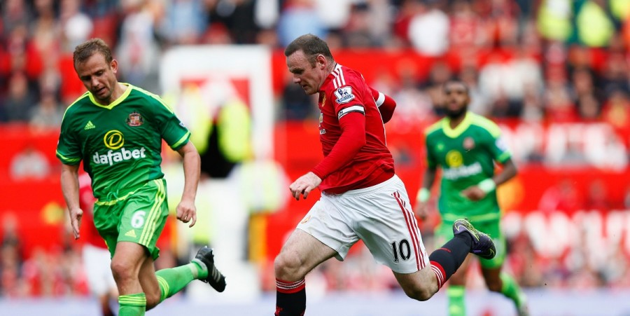 Wayne Rooney of Manchester United and Lee Cattermole of Sunderland compete for the ball during the Barclays Premier League match between Manchester United and Sunderland at Old Trafford on September 26, 2015 in Manchester, United Kingdom.