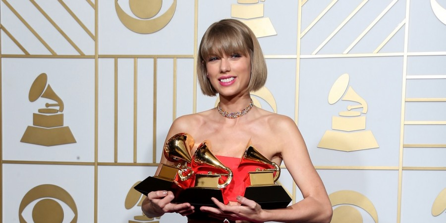 Taylor Swift, winner of the awards for Album of the Year and Best Pop Album for '1989' and Best Music Video for 'Bad Blood,' poses in the press room during The 58th GRAMMY Awards