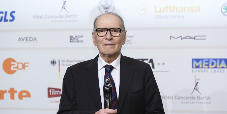 Ennio Morricone poses with his award for european film music at the European Film Awards 2013 on December 7, 2013 in Berlin, Germany.