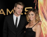 Liam Hemsworth and Miley Cyrus arrive at the premiere of Lionsgate's 'The Hunger Games' at Nokia Theatre L.A. Live on March 12, 2012.