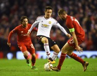 Ander Herrera of Manchester United takes on Joe Allen (L) and Jordan Henderson of Liverpool during the UEFA Europa League Round of 16 first leg match between Liverpool and Manchester United at Anfield on March 10, 2016 in Liverpool, United Kingdom.