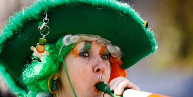 A woman dressed in colours of the Irish flag takes part in the St Patrick's Day parade through central London on March 13, 2016 in London, England.