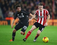 Steven Davis of Southampton evades Joe Allen of Liverpool during the Capital One Cup quarter final match between Southampton and Liverpool at St Mary's Stadium on December 2, 2015 in Southampton, England.