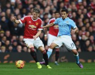 Bastian Schweinsteiger of Manchester United and Jesus Navas of Manchester City compete for the ball during the Barclays Premier League match between Manchester United and Manchester City at Old Trafford on October 25, 2015 in Manchester, England.