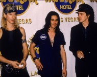 Duff McKagan, Gilby Clarke, and Izzy Stradlin of Guns N' Roses in front of a Hard Rock Cafe banner, Las Vegas, Nevada, 1992.