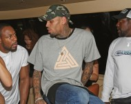 Chris Brown talks with Recording Artist Tank and Former NFL Player Warren Sapp at the WizPak Launch Party Hosted By Chris Brown on May 15, 2016 in Fort Lauderdale, Florida