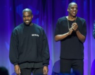 Kanye West (L) and JAY Z onstage at the Tidal launch event #TIDALforALL at Skylight at Moynihan Station on March 30, 2015