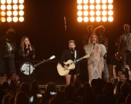 Beyonce (R) performs onstage with Emily Robison and Natalie Maines of Dixie Chicks at the 50th annual CMA Awards