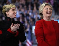 Hillary Clinton (R) and Lady Gaga smile during a campaign rally at North Carolina State University on November 8, 2016 in Raleigh North Carolina