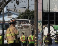 Workers clear debris following a warehouse fire that has claimed the lives of at least thirty people on December 4, 2016 in Oakland, California