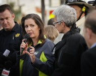Oakland Mayor Libby Schaaf (C) speaks at a media event following a warehouse fire that has claimed the lives of at least thirty-three people on December 4, 2016 in Oakland, California