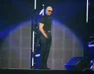 Pitbull performs on stage at iHeartRadio Fiesta Latina at American Airlines Arena on November 5, 2016 in Miami, Florida