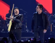 The Edge (L) and Bono of music group U2 perform onstage at the 2016 iHeartRadio Music Festival at T-Mobile Arena on September 23, 2016 in Las Vegas, Nevada