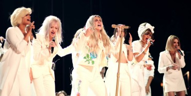 Kesha performing onstage at the 2018 Grammy Awards