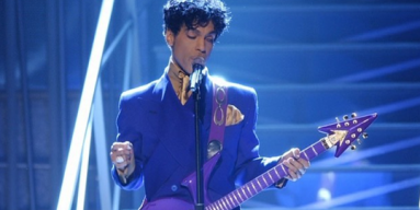 Prince, a prolific guitarist singing with one of his iconic instruments.